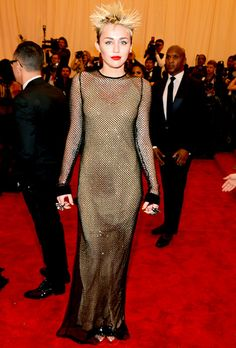 Miley Cyrus looks the part on the punk-themed red carpet at the 2013 #MetGala!