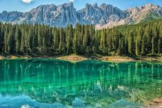 The Karersee (Italian: Lago di Carezza; German: Karersee) is a lake in the Dolomites in South Tyrol, Italy North Carolina Lakes, Northern Italy, Italy Vacation, Future Travel, Landscape Photographers, Outdoor Travel, Dream Vacations, Adventure Travel, Places To Visit