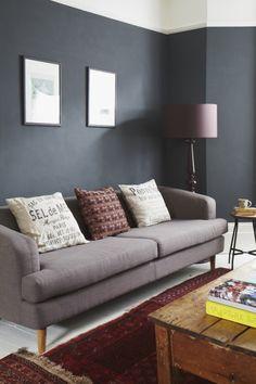 Charcoal walls and grey sofa