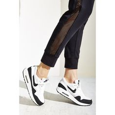 Nike Air Max 1 Essential Sneaker ($100) ❤ liked on Polyvore featuring shoes, sneakers, black, nike trainers, black rubber shoes, nike shoes, long shoes and black sneakers