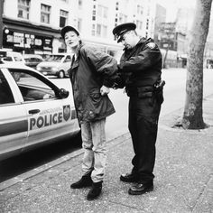 Lincoln Clarkes Photographs | Pigeon Park, West Hastngs & Carrall St. Vancouver, December 20, 2000 | Heroines | Pigeon, Lincoln, Vancouver, Title Page, Police, Park, Photography, Photograph, Fotografie
