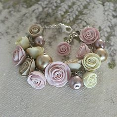 Hand-made bracelet with roses made of polymer clay.