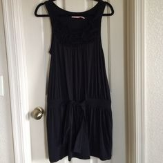 Juicy Couture summer dress Juicy Couture summer dress. Has floral embellishment on top and ties at the waist. Will fit between a 4-6. Perfect for summer. Worn once. No trades Open to reasonable offersPlease use offer button if interested❤️❤ I don't negotiate in comments and don't make low ball offers. Juicy Couture Dresses