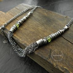Peridot necklace - sterling silver multi chain necklace by studioformood on Etsy https://www.etsy.com/listing/240331270/peridot-necklace-sterling-silver-multi