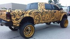 King of Midwest SpadeMade Ram Spade Kreations 2014 Dodge Ram 2500 Mega Cab Avery Dennison Supreme Wrapping Film Matte Black and Avery Dennison Conform Chrome Gold with DOL 1080 overlaminate