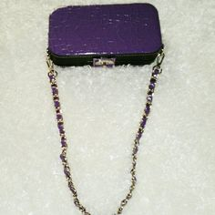 Purple Snake Skin Box Clutch Purse Brand new small clutch purple purse to carry cash and credit cards. Has chain strap with purple strap running through it. Accessories