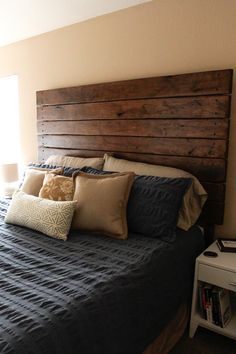 DIY Headboard | Love the little wood buttons that cover the screw placement at the end of the boards