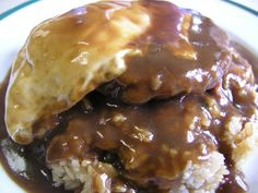 Loco Moco - Must have food when you're in Hawaii! <3 <3 loco moco = white rice, topped with a hamburger patty or some places served flat steak instead, a fried egg, and brown gravy.