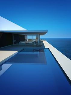 Contemporary pool with views over the ocean. Pinned to Pool Design by Darin Bradbury.