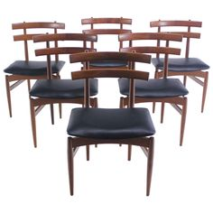 Set of Six Rare Danish Modern Chairs Designed by Poul Hundevad | From a unique collection of antique and modern dining room chairs at https://www.1stdibs.com/furniture/seating/dining-room-chairs/