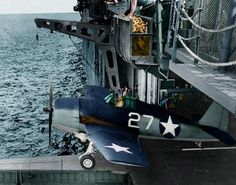 Colorized photo of an F6F Hellcat about to be launched from the seldom used hanger deck catapult of an Essex Class carrier 1943.
