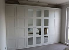If adding mirrors to closet doors, this look doesn't make it look as dated as the full length mirrors