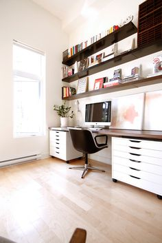 Storage OVER the desk to keep things tidy. It's easier to work in a home office that is organized.