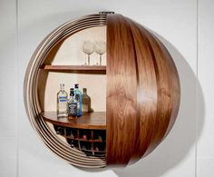 Inspired by a spinning coin, the Dime Cabinet is a hemispherical, wall-mounted furniture piece that can house either a drinks bar, a standing desk, or a mini-kitchen. Several curved segmented panels surround the inner compartment…