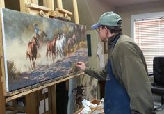 Tom Browning paints a piece of his western art