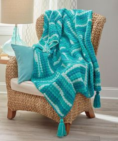 Wavy Squares Throw Free Crochet Pattern. Skill Level: Easy This throw is crocheted just one square at a time, so it's perfect for a take along project on trips or when socializing as you crochet. You'll love how this yarn makes its own stripes, without changing to a new skein. Free Pattern More Patterns Like This!