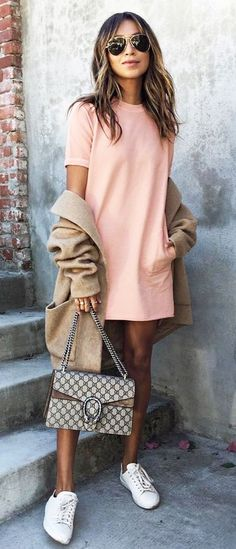 pink dress. camel coat. sneakers. street style.
