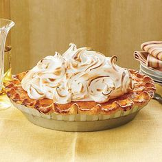 Sweet Potato Pie with Marshmallow Meringue | Wow guests with a sky-high marshmallow meringue on this sweet potato pie. Be sure to lightly pack the mashed sweet potatoes in your measuring cup for a fluffy filling. | SouthernLiving.com