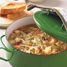 Satisfy your family's appetite with dinners for 10 bucks or less like our Cabbage and Bacon Soup with Garlic Bread