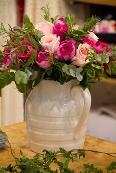 White pitcher with pink roses