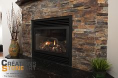 Fireplace done with Terracotta Ledgestone from Realstone Systems and black granite slab for Hearth.