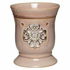 Scentsy Mother's Day Premium Full Size Warmer by Scentsy. $39.00. Soft mauve finish topped by a luxe medallion of interconnected silver hearts, spangled with sparkling rhinestones