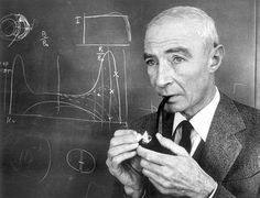 Robert Oppenheimer - Atomic scientist lights his pipe in front of a chalk drawing on a blackboard. J Robert Oppenheimer, Cigar Smoking, Pipe Smoking, Math Quotes, Art Of Manliness, Pipes And Cigars, Chalk Drawings, People Of Interest, People Laughing