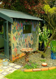 The Mosaic Garden Waihi N.Z.  ~  This one is mosaic.  It could be painted.  Make the shed a part of the garden.