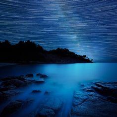 Star trails and the milky way, seen from a beach, Trédrez-Locquémeau, France // David Keochkerian