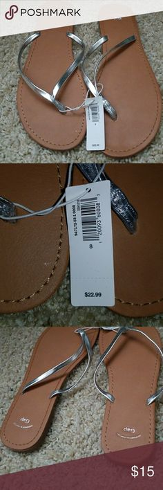GAP flip flops Nwt silver flip flops from Gap. Size 8 but i wear 8.5 and they fit fine. Cant wear flat shoes anymore due to foot problem GAP Shoes Sandals