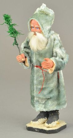 "BLUE ROBE SANTA CANDY CONTAINER : Lot 2255, Germany, composition Santa in blue robe, rabbit fur beard and holding a feather tree sprig. 10"", $1,100"