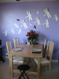 Cut dragon flies or butterflies out of craft foam and tape (masking tape makes them removable) to the wall.  The wings will pull away from the wall just a bit for a 3D effect. Would also look great for a little girl's bedroom or nursery.