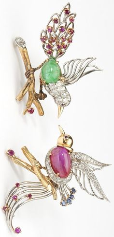 Circa 1960, 18K yellow and white gold, one bird set with a cabochon ruby body, 4 round sapphires, 7 round rubies and 25 full-cut round diamonds; the other bird set with a cabochon emerald body, 17 round rubies, and 13 round diamonds; diamonds totaling approximately 1.20 cts, and graded H-I color and VS clarity, 26.5 gms, 2''