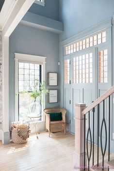 Traditional Fall Foyer Decorating Ideas with World Market! Our small traditional powder blue foyer with Fall decorating ideas with World Market! Hallway Colour Schemes, Hallway Colours, Blue Grey Walls, Light Blue Walls, Grey Front Doors, Front Doors With Windows, Foyer Design, Stair Design, Blue Hallway