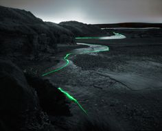 Illuminated light source floats down a river