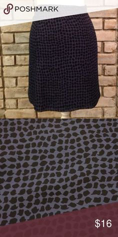Beautiful Flowing Skirt In perfect condition. Blue and black fully lined skirt. Measures 17 1/2 inches long. Banana Republic Skirts