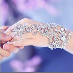 Elegant Wedding Bridal Jewelry Bracelet Material: Organza, Rhinestone, never used.. Last two picures is of the actual bracelet. I have three in total of this bracelet but the other two clasp are broken but easily repaired. But all three have never been used. Jewelry Bracelets
