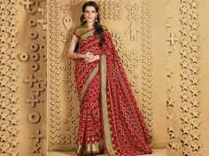 """#Laxmipati provides the Red & Beige georgette printed sarees along with bhagalpuri silk olive green blouse for your occasions like Casual Evening. Make your moments melodious with """"SANGEET"""" #Catalogue. Price - Rs. 1658.00 Visit for more designs@ www.laxmipati.com #ReadyToWear #OccasionWear #Ethnicwear #FestivalSarees #Fashion #Fashionista #Couture #SANGEET 0816 #LaxmipatiSaree #autumn #winter #women #her #she #mystery #lingerie #black #lifestyle #life #ColoursOfIndia #HappyBride #WhoYouAre… Laxmipati Sarees, Green Blouse, Printed Sarees, Occasion Wear, Daily Wear, Bridal Collection, Olive Green, Catalog, Print Design"""