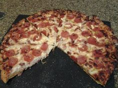 A 5-star recipe for Pizza Dough made with water, oil, bread flour, sugar, salt, active dry