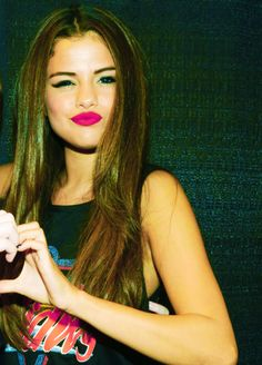 Selena Gomez..... Graphic tee straight hair and pink bold lip
