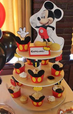 Fun cupcakes at a Mickey Mouse baptism party! See more party ideas at CatchMyParty.com!