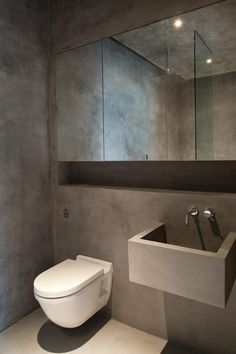 Clanricarde Gardens, Notting Hill by Ardesia Design. Beautiful and unique concrete and polished plaster bathroom.