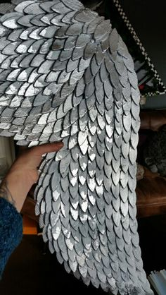 Glue  woodworkers biscuits on a rigid backing Grey distressed wings with silver tips made by me!