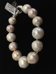 Genuine Natural Rare Light Mauve Pink Genuine 14mm Nucleated Kasumi like Pearl Bracelet 8  A Lovely Bracelet! We are adding many this week as our Fine This is Chinese! Bracelet made of LARGE gorgeous, BEAD NUCLEATED Fresh Water cultured pearls. These Unique One Of A Kind BAROQUE pearl necklace exhibits a wonderful luster and very thick skin/nacre; ranging in color from light pink, beige, mauve  They are In-Body Bead Nucleatedl cultured pearls  Fits size 8 inch Unisex for Men or Women  Sh...