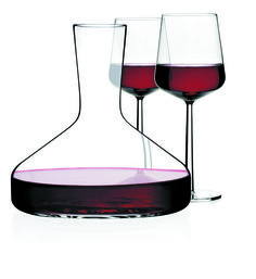 Classic handblown glass decanter with red wine glasses