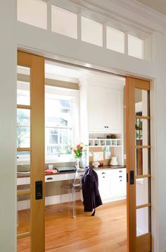 Double pocket doors with glass panels are also helpful when you want to close off an area, like a home office, while still letting light through to the rest of the home.Traditional Home Office by Emerick Architects