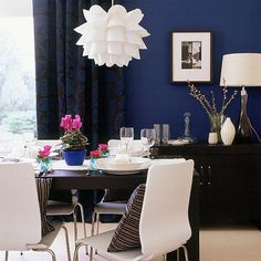 Love it - midnight blue dining room - but with round table and nicer chairs