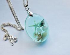 The Mermaid's Necklace Oval Nautical Jewelry Resin Starfish Tiny Seashells Aqua Specimen Necklace Fairy Tale Fantasy Unique Handmade. $48.00, via Etsy.