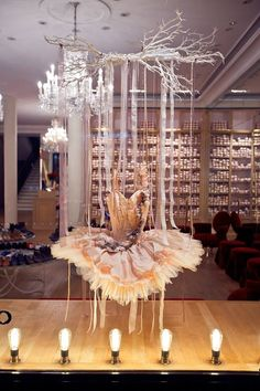 Repetto store in Paris. I like this display. it is simple and from the background from what i see in the store, it mirrors that. The use of the strings hanging in the back create a subtle background and character .