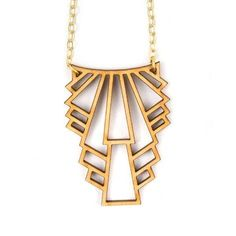 Layer this art deco-inspired wooden necklace with shorter necklaces for a perfect spring look. #etsyjewelry